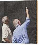 Veterans Look For A Fallen Soldier's Name On The Vietnam War Memorial Wall Wood Print