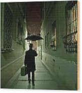 Victorian Man With Top Hat Carrying A Suitcase And Umbrella Walking In The Narrow Street At Night Wood Print