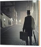 Victorian Man With Top Hat Carrying A Suitcase Walking In The Old Town At Night Wood Print