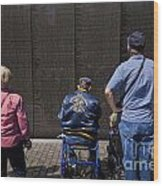 Vietnam Veterans Paying Respect To Fallen Soldiers At The Vietnam War Memorial Wood Print
