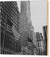 view of pennsylvania bldg nelson tower and US flags flying on 34th street from 1 penn plaza new york Wood Print