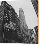 view of pennsylvania bldg nelson tower and US flags flying on 34th street from 1 penn plaza nyc Wood Print by Joe Fox