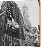 view of pennsylvania bldg nelson tower and US flags flying on 34th street new york city Wood Print