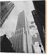 View Of The Empire State Building And Surrounding Buildings And Cloudy Sky West 33rd Street New York Wood Print