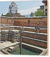 View Of White Temple From Pool Area Behind Bhaktapur Durbar Square In Bhaktapur-nepal - Wood Print