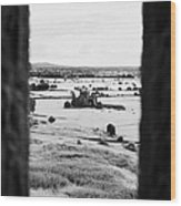 viewpoint looking out through stone fortifications towards hore abbey from the Rock of Cashe Wood Print