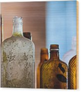Vintage Bottles Wood Print by Adam Romanowicz