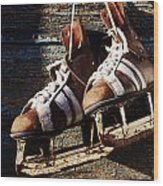 Vintage Pair Of Mens  Ice Skates Hanging On A Wooden Wall With C Wood Print