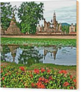 Wat Mahathat Reflection In 13th Century Sukhothai Historical Park-thailand Wood Print