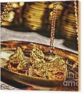 Weighing Gold Wood Print