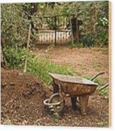Wheel Barrow Next To Soil Heap Wood Print