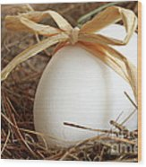 White Egg With Bow On Straw  Wood Print by Sandra Cunningham