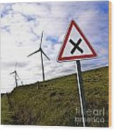 Wind Turbines On The Edge Of A Field With A Road Sign In Foreground. Wood Print