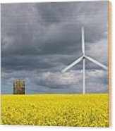 Windmill With Motion Blur In Rapeseed Field Wood Print
