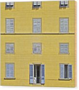 Windows Of Florence Against A Faded Yellow Plaster Wall Wood Print