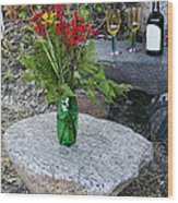 Wine And Red Flowers On The Rocks Wood Print