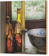 Wine - Nestled In A Corner Of A Window Sill  Wood Print by Mike Savad