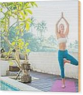 Woman Doing Yoga In The Morning Wood Print
