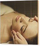 Woman Having A Facial Massage Wood Print