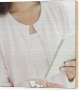 Woman Holding Pills And Digital Tablet Wood Print