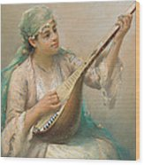 Woman Playing A String Instrument Wood Print
