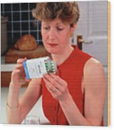 Woman Reading Dose Label On Pack Of Prozac Pills Wood Print