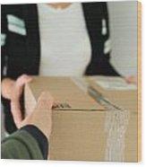 Woman Receiving Parcel Wood Print