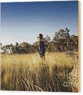 Woman Running Through Field Wood Print