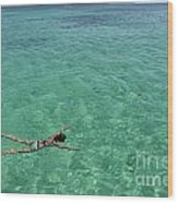 Woman Snorkeling By Turquoise Sea Wood Print