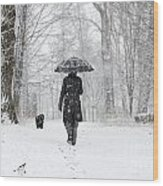 Woman Walking In A Snowy Forest Wood Print