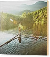 Woman Walking On Log In Alpine  Lake Wood Print