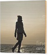 Woman Walking On The Lake Front Wood Print