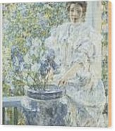 Woman With A Vase Of Irises Wood Print