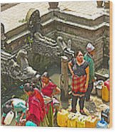 Women Get Bagmati River Holy Water From Ornate Fountains In Patan Durbar Square In Lalitpur-nepal  Wood Print