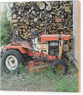 Wood Pile And Lawn Tractor Wood Print