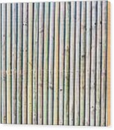 Wooden Poles Wood Print by Tom Gowanlock