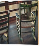 Wooden Rocking Chairs On A Deck Wood Print