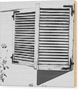 wooden sun shutter blinds on windows of house with roses in the garden in tacoronte Tenerife Canary Islands Spain Wood Print