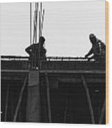 Workers Preparing Iron Girders As Part Of Laying The Roof Wood Print