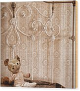 Worn Teddy Bear On Brass Bed Wood Print