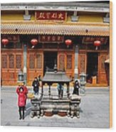Worshipers In Urn Courtyard Of Chinese Temple Shanghai China Wood Print