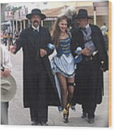Wyatt Earp  Doc Holliday Escort  Woman  With O.k. Corral In  Background 2004 Wood Print