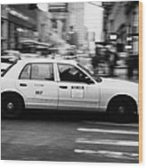 Yellow Cab Blurring Past Crosswalk And Pedestrians New York City Usa Wood Print