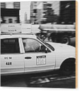 Yellow Cab With Advertising Hoarding Blurring Past Crosswalk And Pedestrians New York City Usa Wood Print