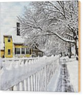 Yellow House With Snow Covered Picket Fence Wood Print