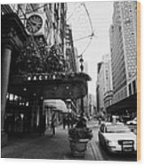 yellow taxi cab waits outside entrance to Macys department store on Broadway and 34th street Wood Print by Joe Fox