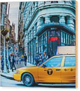 Yellow Taxi In Front Of New York City's Flatiron Building Wood Print