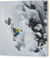 Young Adult Snowboarding Off Powder Wood Print