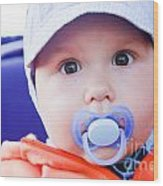 Young Baby Boy With A Dummy In His Mouth Outdoors Wood Print