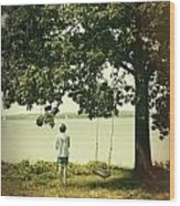 Young Boy Looking Out At The Water Under A Big Tree Wood Print